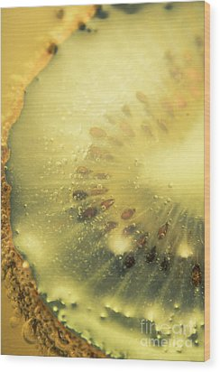 Macro Shot Of Submerged Kiwi Fruit Wood Print by Jorgo Photography - Wall Art Gallery