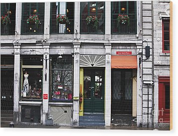 Montreal Shops Wood Print by John Rizzuto