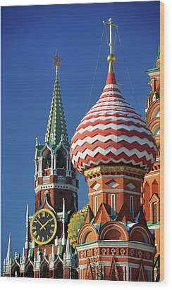 Moscow, Spasskaya Tower And St. Basil Cathedral Wood Print by Vladimir Zakharov