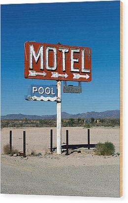 Motel Sign On I-40 And Old Route 66 Wood Print by Scott Sawyer