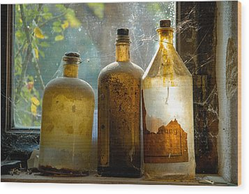 Old And Dusty Glass Bottles Wood Print by Matthias Hauser