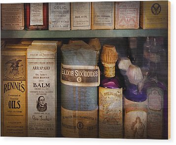 Pharmacy - Oils And Balms Wood Print by Mike Savad