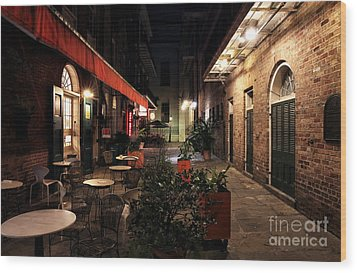 Pirates Alley At Night Wood Print by John Rizzuto