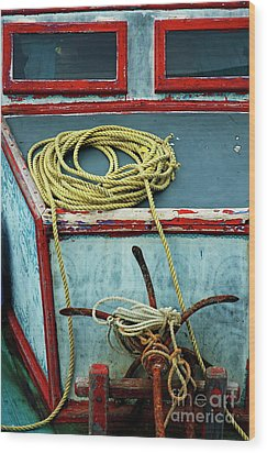 Ropes And Rusty Anchors On A Boat Deck Wood Print by Sami Sarkis