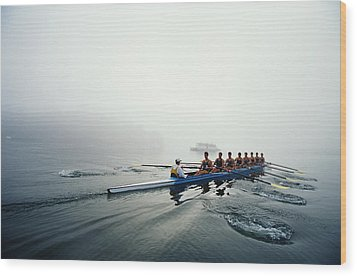 Rowing Team On Lake In Early Morning Fog Wood Print by Nick Wilson