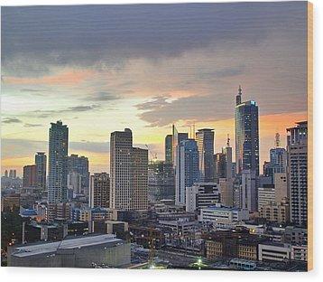 Sunset Over  Makati City, Manila Wood Print by Neil Howard