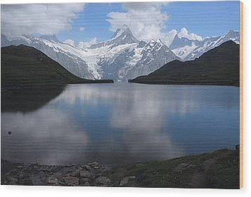 Swiss Alps And Clouds Casting Wood Print by Anne Keiser