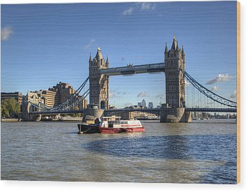 Tower Bridge With Canary Wharf In The Background Wood Print by Chris Day