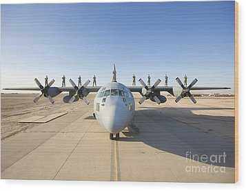Troops Stand On The Wings Of A C-130 Wood Print by Terry Moore
