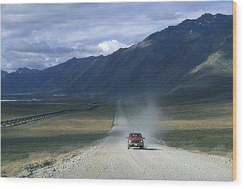 Truck On The Dalton Highway Following Wood Print by Rich Reid