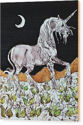 Unicorn Over Flower Field Wood Print by Carol  Law Conklin