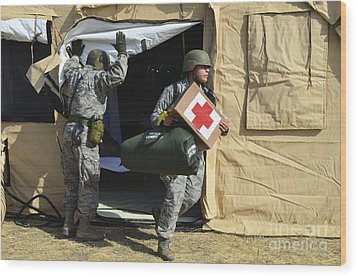 U.s. Air Force Soldier Exits A Medical Wood Print by Stocktrek Images