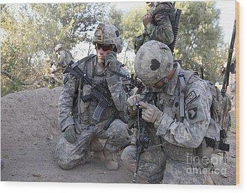 U.s. Army Soldier Radios In His Teams Wood Print by Stocktrek Images