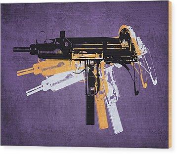 Uzi Sub Machine Gun On Purple Wood Print by Michael Tompsett