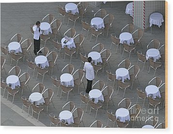 Waiters At Empty Cafe Terrace On Piazza San Marco Wood Print by Sami Sarkis