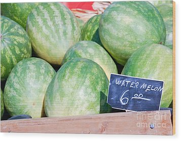 Watermelons With A Price Sign Wood Print by Paul Velgos