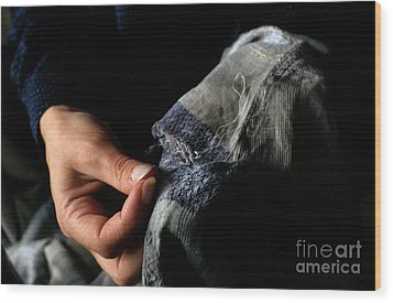 Woman Fixing A Hole With A Needle And Thread Wood Print by Sami Sarkis