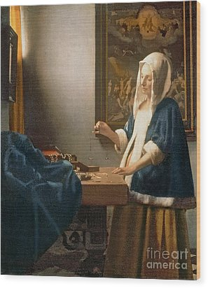 Woman Holding A Balance Painting by Jan Vermeer