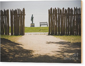 Wooden Fence And Statue Of John Smith Wood Print by Roberto Westbrook