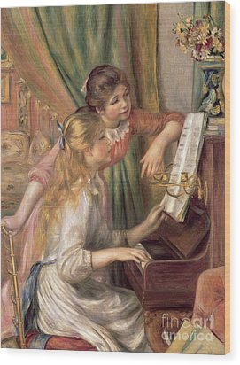 Young Girls At The Piano Wood Print by Pierre Auguste Renoir
