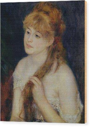 Young Woman Braiding Her Hair Wood Print by Pierre Auguste Renoir