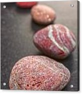 Curving Line Of Red And Grey Pebbles On Dark Background Acrylic Print by Colin and Linda McKie
