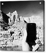 man taking photos with smartphone during boat ride along the colorado river in the grand canyon Ariz Acrylic Print by Joe Fox