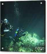 A Young Married Couple Scuba Diving Acrylic Print by Michael Wood