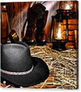 Black Cowboy Hat In An Old Barn Acrylic Print by Olivier Le Queinec
