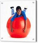 Boy Balancing On Exercise Ball Acrylic Print by Ron Nickel