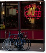 Central Cafe Bicycles Acrylic Print by Susan Candelario