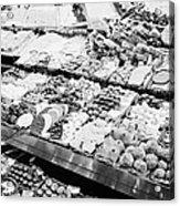 chocolates on display inside the la boqueria market in Barcelona Catalonia Spain Acrylic Print by Joe Fox