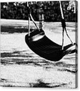 Empty Plastic Swing Swinging In A Garden In The Evening Acrylic Print by Joe Fox