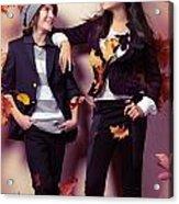 Fashionably Dressed Boy And Teenage Girl Under Falling Autumn Le Acrylic Print by Oleksiy Maksymenko