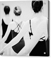 Female Teenage Ballet Students Holding On To A Ballet Barre At A Ballet School In The Uk Acrylic Print by Joe Fox