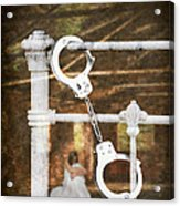 Handcuffs On Bed Acrylic Print by Amanda Elwell
