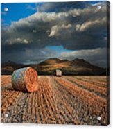 Landscape Of Hay Bales In Front Of Mountain Range With Dramatic  Acrylic Print by Matthew Gibson