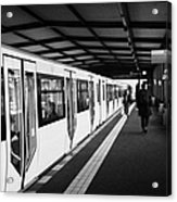 modern yellow u-bahn train sitting at station platform Berlin Germany Acrylic Print by Joe Fox