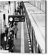 passengers along ubahn train platform Friedrichstrasse Friedrichstrasse u-bahn station Berlin Acrylic Print by Joe Fox
