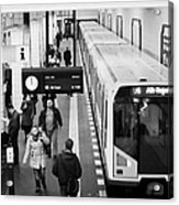 passengers on ubahn train platform as train leaves Friedrichstrasse u-bahn station Berlin Germany Acrylic Print by Joe Fox