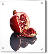 Pomegranate Opened Up On Reflective Surface Acrylic Print by Johan Swanepoel