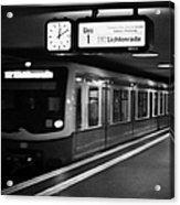 s-bahn train speeding through unter den linden underground station Berlin Germany Acrylic Print by Joe Fox