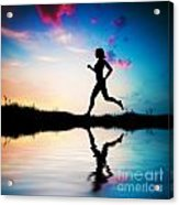 Silhouette Of Woman Running At Sunset Acrylic Print by Michal Bednarek