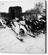 snowmobiles parked in Kamsack Saskatchewan Canada Acrylic Print by Joe Fox