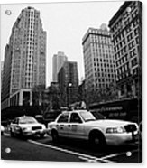 Steam Of Yellow Cabs With Headlights On Heading Down Broadway At Herald Square Outside Macys Nyc Usa Acrylic Print by Joe Fox
