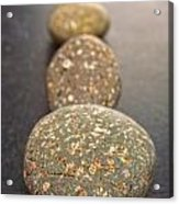Straight Line Of Speckled Grey Pebbles On Dark Background Acrylic Print by Colin and Linda McKie