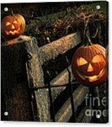 Two Halloween Pumpkins Sitting On Fence Acrylic Print by Sandra Cunningham