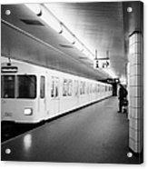 u-bahn train pulling in to ubahn station Berlin Germany Acrylic Print by Joe Fox