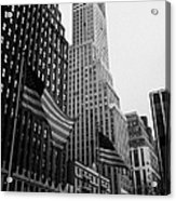 view of pennsylvania bldg nelson tower and US flags flying on 34th street from 1 penn plaza new york Acrylic Print by Joe Fox