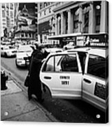 white middle aged passengers exit from yellow cab rear door at taxi rank on 7th Avenue Acrylic Print by Joe Fox